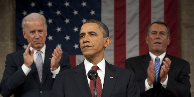 FILE -- Jan. 24, 2013: President Obama delivers his State of the Union address on Capitol Hill, as Vice President Joe Biden and House Speaker John Boehner, right, applaud.
