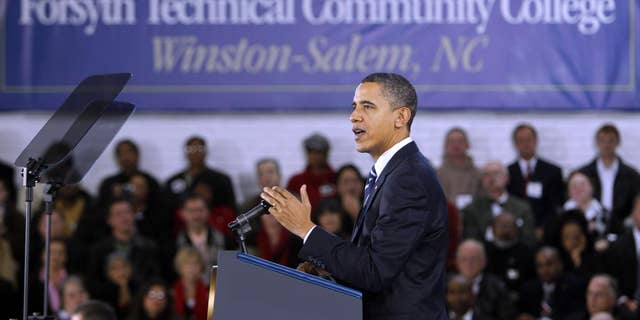 President Barack Obama gestures while speaking during a visit to Forsyth Technical Community College in Winston-Salem, N.C., Monday, Dec. 6, 2010. (AP Photo/Chuck Burton)