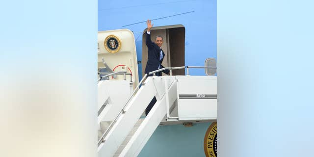 President Obama boards Air Force One/AP