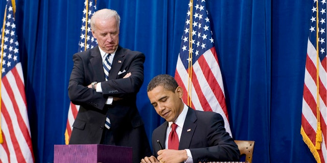 FILE: Feb. 17, 2009: President Obama signs the American Recovery and Reinvestment Act, next to Vice President Biden, in Denver, Colo.