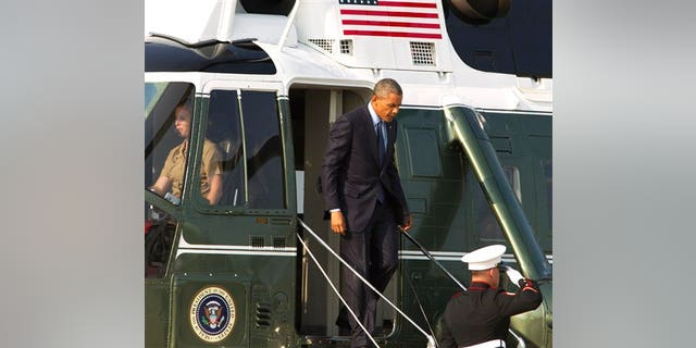 President Barack Obama steps of  Marine One upon arrival at Andrews Air Force Base, Md., on Tuesday, July 29, 2014, en route to Kansas City, Mo. (AP Photo/Jose Luis Magana)