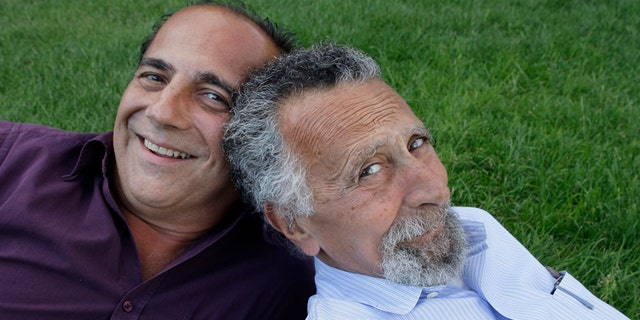 """In this June 19, 2008 photo, brothers Ray, left, and Tom Magliozzi, co-hosts of National Public Radio's """"Car Talk"""" show, pose for a photo in Cambridge, Mass. NPR says Tom Magliozzi died Monday, Nov. 3, 2014 of complications from Alzheimer's disease. He was 77. (AP Photo/Charles Krupa)"""