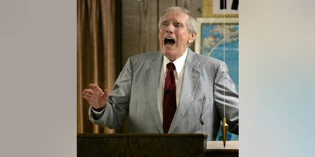 FILE - In this March 19, 2006 file photo, the Rev. Fred Phelps Sr. preaches at his Westboro Baptist Church in Topeka, Kan. Phelps, the founder of the Kansas church known for anti-gay protests and pickets at military funerals, died Thursday, March 20, 2014. He was 84. (AP Photo/Charlie Riedel, File)