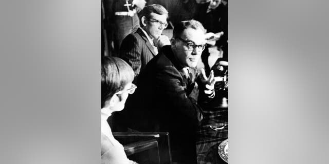 FILE - In this March 13, 1973 file photo, John T. Downey, a former Central Intelligence Agency agent who spent 20 years as a prisoner in China during the Cold War, speaks during a news conference in New Britain, Conn. The office of Connecticut Gov. Dannel P. Malloy said that Downey, who later served as a Connecticut judge, died Monday, Nov. 17, 2014. He was 84. (AP Photo/Bob Child, File)