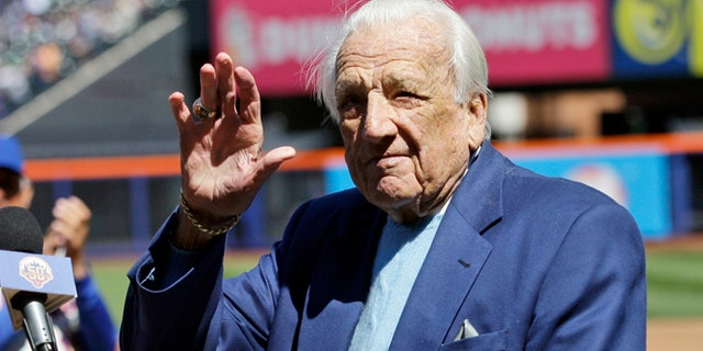 April 5, 2012: In this file photo, Hall of Famer Ralph Kiner waves to the crowd before announcing the New York Mets starting line-up before an opening day baseball game against the Atlanta Braves at Citi Field in New York.