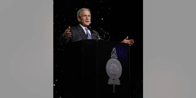 In a photo provided by the University of Mobile, former President George W. Bush addresses the 6th-annual University of Mobile Leadership Banquet at the Arthur Outlaw Convention Center Thursday, Oct.7, 2010 in Mobile, Ala. (AP Photo/University of Mobile)