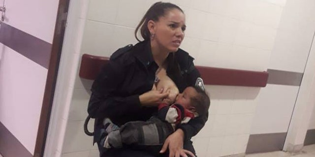 A photo of a police officer breastfeeding a malnourished child has gone viral on social media
