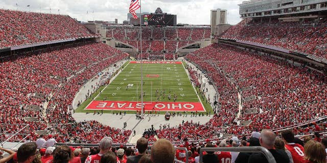 FILE - In this Sept. 21, 2013, file photo, Ohio State plays against Florida A&M at Ohio Stadium during an NCAA college football game in Columbus, Ohio. While Michigan has Michigan State and Indiana has Purdue and Notre Dame, Ohio State has no real big-time football competition within its borders. Or, at least, it hasn't for more than 90 years. The Buckeyes have won their last 38 meetings with other colleges from the state heading into Saturday's game against Kent State. (AP Photo/Jay LaPrete, File)