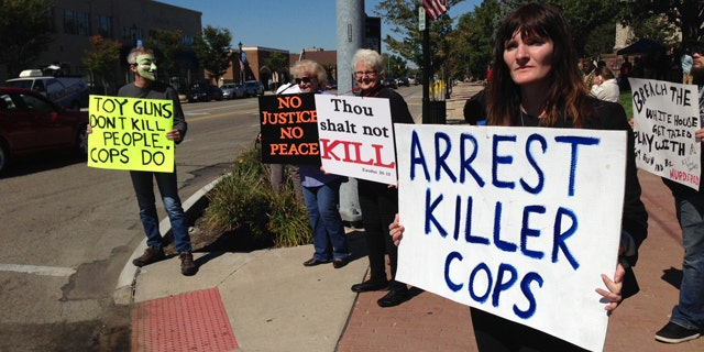 September 22, 2014: About 100 people rally in support of John Crawford Jr. and his family during the grand jury investigation into the Aug. 5 shooting of John Crawford III, in Beavercreek,Ohio. (AP Photo/The Daily News, Ty Greenlees)