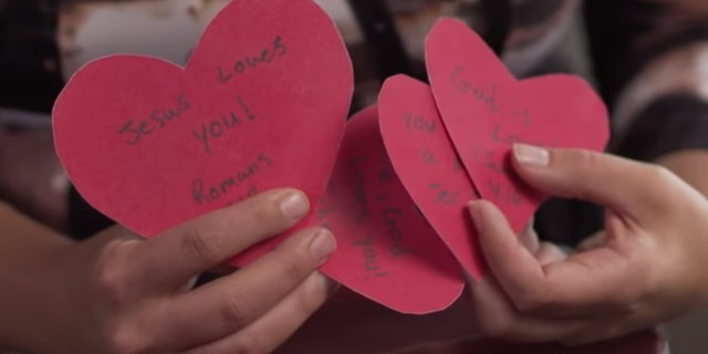 Valentine's cards student Polly Olsen was stopped from handing out on campus by a security officer.