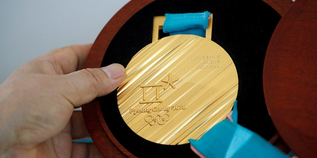 A gold medal for the Pyeongchang 2018 Winter Olympic Games is seen during its unveiling ceremony in Seoul, South Korea, Sept. 21, 2017. (Reuters)