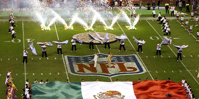 """FILE - In this Oct. 2, 2005, file photo, performers are shown prior to the start of a regular season NFL game between the Arizona Cardinals and San Francisco 49ers at Azteca Stadium in Mexico City, Mexico. Eleven years after the network telecast an NFL game from Mexico City, it will do so again when the Raiders """"host"""" the Texans on Monday night. (AP Photo/Marco Ugargte, File)"""