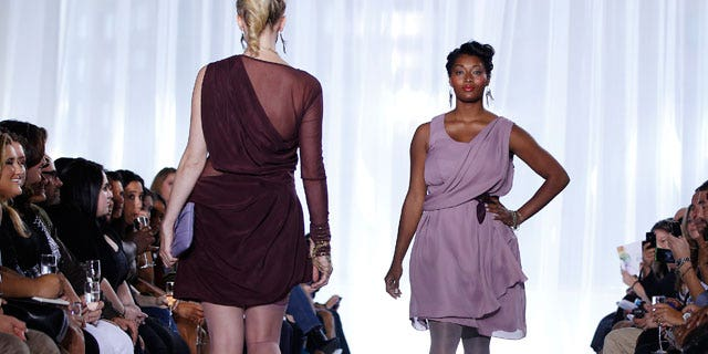 Plus size models work the runway at a fashion show during New York Fashion Week.