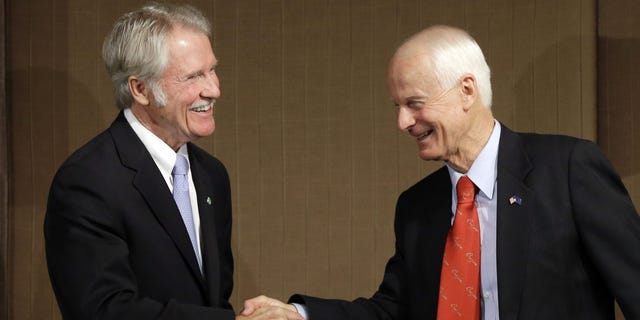 Oct. 10, 2014: Oregon Democratic Gov. John Kitzhaber, left, shakes hands with Republican challenger Dennis Richardson.