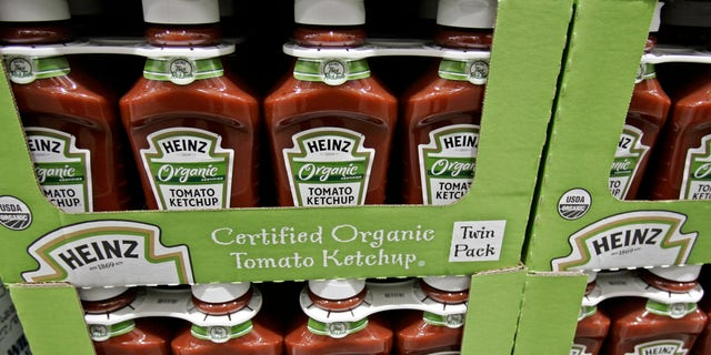 FILE - In this Feb. 22, 2009, file photo, bottles of Heinz organic tomato ketchup are on display inside Costco in Mountain View, Calif. The organic industry is gaining clout on Capitol Hill, prompted by rising consumer demand and its entry into traditional farm states. But that isnt going over well with everyone in Congress. Tensions between conventional and organic agriculture boiled over this week during a late-night House Agriculture Committee debate on a sweeping farm bill that has for decades propped up traditional crops and largely ignored organics. (AP Photo/Paul Sakuma)