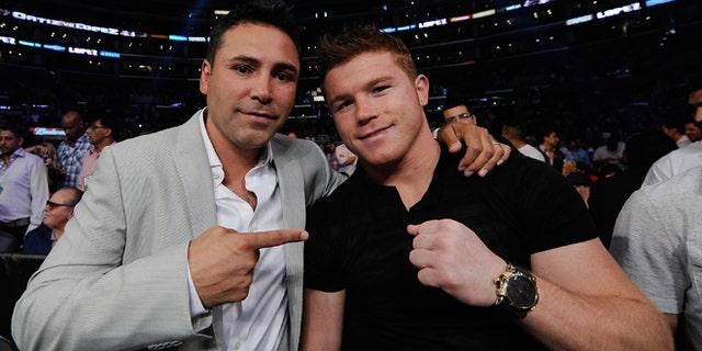 Oscar De La Hoya and Mexican boxer Canelo Alvarez on June 23, 2012 in Los Angeles, California.