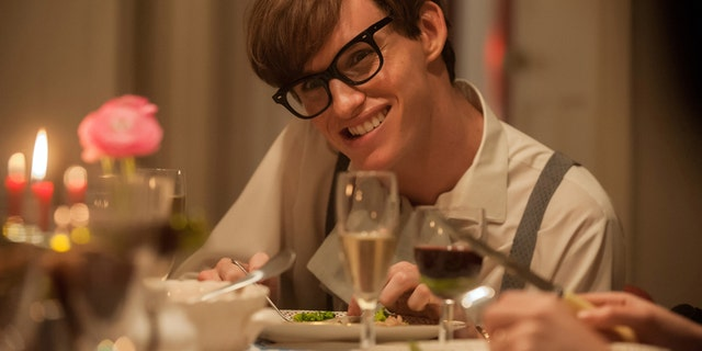 """This photo provided by Focus Features, LLC shows, Eddie Redmayne, as Stephen Hawking, in a scene from the film, """"The Theory of Everything."""" The actor is nominated for an Oscar for his portrayal of the ALS-afflicted Stephen Hawking in the film.  The 87th annual Academy Awards are presented on Sunday, Feb. 22, 2015, in Los Angeles. (AP Photo/Focus Features, LLC, Liam Daniel)"""