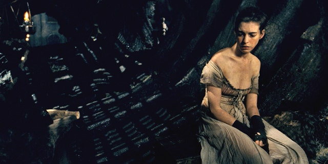 "This image released by Universal Pictures shows Anne Hathaway as Fantine in a scene from ""Les Misérables.""  The costumes for the film were designed by Spanish designer Paco Delgado. Delgado is nominated for an Academy Award for his costumes from the film. The 85th Academy Awards will be held on Sunday, Feb. 24. (AP Photo/Universal Pictures)"