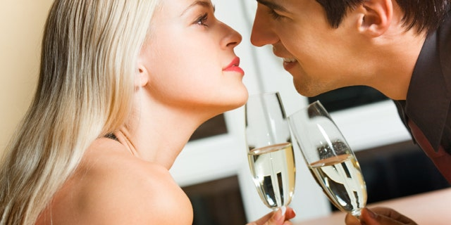 Is getting this close at a restaurant okay, or should couples save their kissing for somewhere more private?