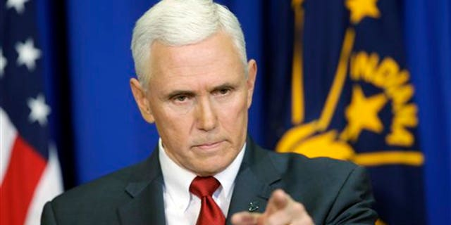 Indiana Gov. Mike Pence takes a question during a news conference, Tuesday, March 31, 2015, in Indianapolis. (AP Photo/Darron Cummings)