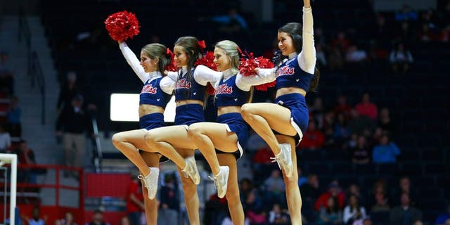 Jan 3, 2015; Oxford, MS, USA; Mississippi Rebels cheerleaders entertain the crowd during the game against the Austin Peay Governors at C.M. Tad Smith Coliseum. Mississippi Rebels defeat the Austin Peay Governors 92-63. Mandatory Credit: Spruce Derden-USA TODAY Sports