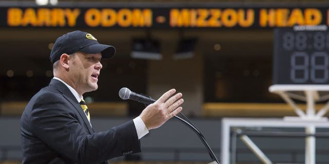 Barry Odom talks to a crowd gathered at Mizzou Arena as he is announced as the new head coach for the NCAA college Missouri football team Friday, Dec. 4, 2015, in Columbia, Mo. (AP Photo/L.G. Patterson)