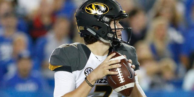 Sep 26, 2015; Lexington, KY, USA; Missouri Tigers quarterback Drew Lock (3) passes the ball against the Kentucky Wildcats at Commonwealth Stadium. Kentucky defeated Missouri Tigers 21-13. Mandatory Credit: Mark Zerof-USA TODAY Sports