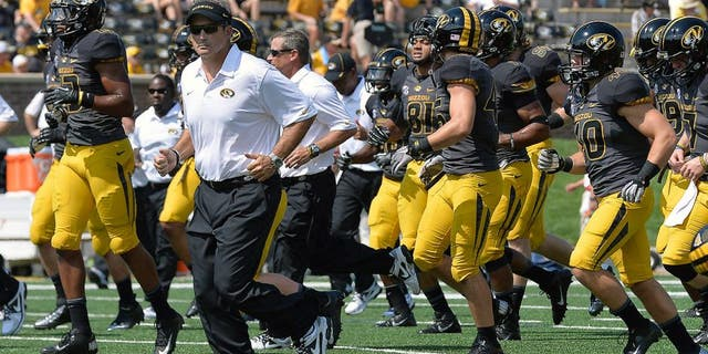 Sep 7, 2013; Columbia, MO, USA; Missouri Tigers head coach Gary Pinkel leads his team off the field prior to the game between the Missouri Tigers and the Toledo Rockets at Faurot Field. Mandatory Credit: Jasen Vinlove-USA TODAY Sports
