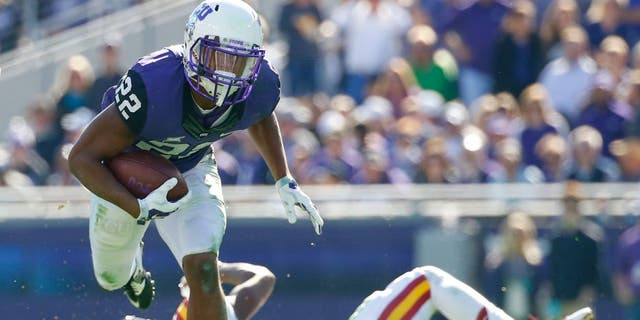 Dec 6, 2014; Fort Worth, TX, USA; TCU Horned Frogs running back Aaron Green (22) runs during the first half against the Iowa State Cyclones at Amon G. Carter Stadium. Mandatory Credit: Kevin Jairaj-USA TODAY Sports