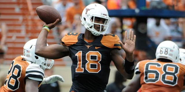 Apr 19, 2014; Austin, TX, USA; Texas Longhorns quarterback Tyrone Swoopes (18) passes the ball during the Spring Game at Texas Memorial Stadium. Mandatory Credit: Brendan Maloney-USA TODAY Sports