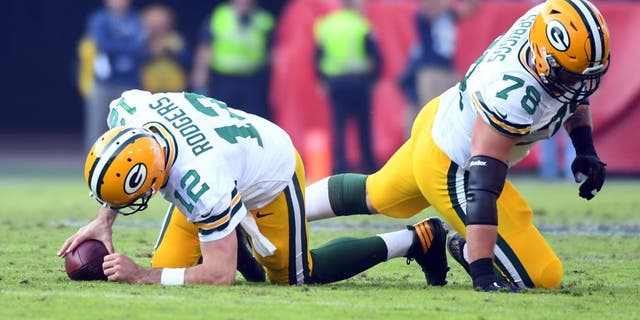 Nov 13, 2016; Nashville, TN, USA; Green Bay Packers quarterback Aaron Rodgers (12) and tackle Jason Spriggs (78) react after a sack during the second half against the Tennessee Titans at Nissan Stadium. The Titans won 47-25. Mandatory Credit: Christopher Hanewinckel-USA TODAY Sports
