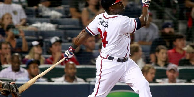 Aug 6, 2015; Atlanta, GA, USA; Atlanta Braves right fielder Adonis Garcia (24) hits a two-run home run in the fifth inning of their game against the Miami Marlins at Turner Field. The Braves won 9-8. Mandatory Credit: Jason Getz-USA TODAY Sports