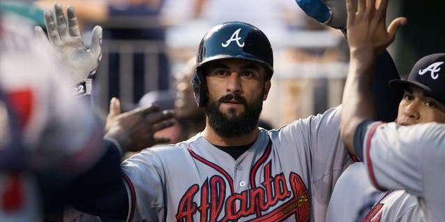 Sep 9, 2015; Philadelphia, PA, USA; Atlanta Braves right fielder Nick Markakis (22) celebrates in the dugout after scoring against the Philadelphia Phillies during the first inning at Citizens Bank Park. Mandatory Credit: Bill Streicher-USA TODAY Sports