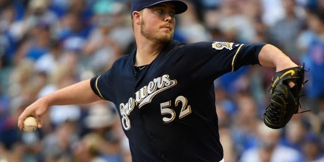 Jul 30, 2015; Milwaukee, WI, USA; Milwaukee Brewers pitcher Jimmy Nelson (52) pitches in the first inning against the Chicago Cubs at Miller Park. Mandatory Credit: Benny Sieu-USA TODAY Sports