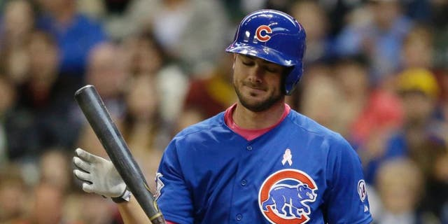 The Chicago Cubs' Kris Bryant strikes out against the Milwaukee Brewers during the first inning Sunday, May 10, 2015, in Milwaukee.