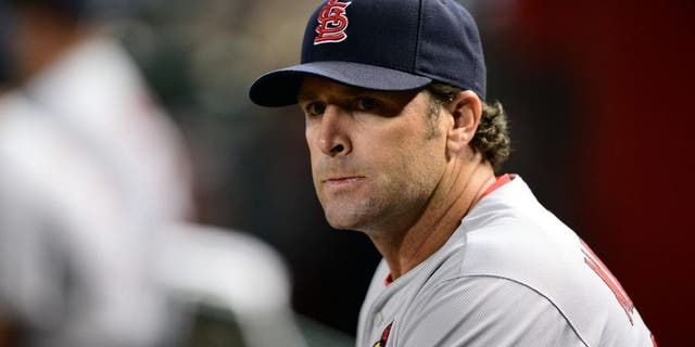 Aug 25, 2015; Phoenix, AZ, USA; St. Louis Cardinals manager Mike Matheny (26) looks on against the Arizona Diamondbacks during the first inning at Chase Field. Mandatory Credit: Joe Camporeale-USA TODAY Sports