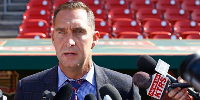 St. Louis Cardinals General Manager John Mozeliak addresses members of the media regarding the condition of Adam Wainwright, prior to a baseball game against the Philadelphia Phillies, Monday, April 27, 2015, in St. Louis. Mozeliak confirmed Wainwright has a torn Achilles and will require season ending surgery. (AP Photo/Billy Hurst)