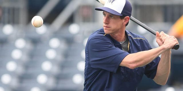 Jun 8, 2015; Pittsburgh, PA, USA; Milwaukee Brewers manager Craig Counsell hits during infield practice before the game against the Pittsburgh Pirates at PNC Park.