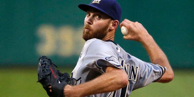 Milwaukee Brewers starting pitcher Taylor Jungmann delivers in the seventh inning of his first major league start during a baseball game against the Pittsburgh Pirates in Pittsburgh, Tuesday, June 9, 2015.