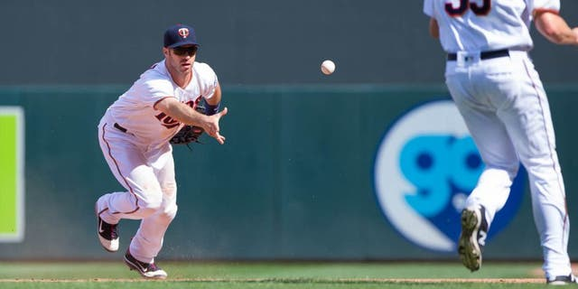 Minnesota Twins first baseman Joe Mauer (left) tosses the ball to relief pitcher Michael Tonkin for an out in the 10th inning against the Boston Red Sox at Target Field in Minneapolis on June 12, 2016. The Twins won 7-4 in 10 innings.