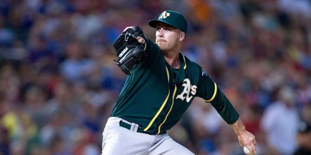 Jul 25, 2014; Arlington, TX, USA; Oakland Athletics relief pitcher Eric O'Flaherty (39) pitches during the game against the Texas Rangers at Globe Life Park in Arlington. The Rangers defeated the Athletics 4-1. Mandatory Credit: Jerome Miron-USA TODAY Sports
