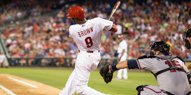 Jul 31, 2015; Philadelphia, PA, USA; Philadelphia Phillies right fielder Domonic Brown (9) hits a two RBI home run during the fifth inning against the Atlanta Braves at Citizens Bank Park. Mandatory Credit: Bill Streicher-USA TODAY Sports