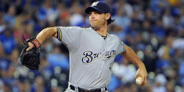 Jun 17, 2015; Kansas City, MO, USA; Milwaukee Brewers relief pitcher Neal Cotts (48) delivers a pitch against the Kansas City Royals in the seventh inning at Kauffman Stadium. Kansas City won the game 10-2.