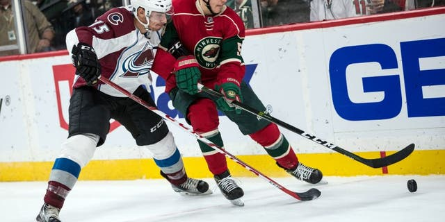 Sep 27, 2016; Saint Paul, MN, USA; Minnesota Wild forward Joel Eriksson Ek (54) protects the puck from Colorado Avalanche defenseman Duncan Siemens (15) during the second period of a preseason hockey game at Xcel Energy Center. Mandatory Credit: Brace Hemmelgarn-USA TODAY Sports