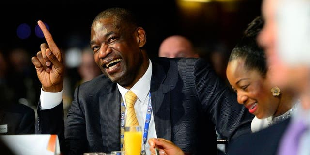 Feb 16, 2014; New Orleans, LA, USA; NBA legend Dikembe Mutombo laughs during the 2014 NBA All-Star Game Legends Brunch at Ernest N. Morial Convention Center. Mandatory Credit: Bob Donnan-USA TODAY Sports