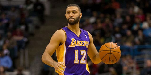 Mar 27, 2014; Milwaukee, WI, USA; Los Angeles Lakers guard Kendall Marshall (12) during the game against the Milwaukee Bucks at BMO Harris Bradley Center. Milwaukee won 108-105.