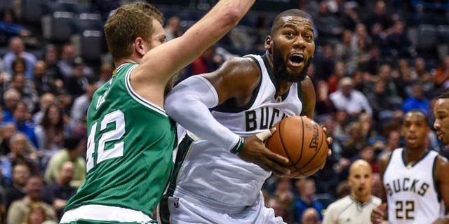 Milwaukee Bucks center Greg Monroe looks for a shot against Boston Celtics forward David Lee in the second quarter at BMO Harris Bradley Center in Milwaukee on Nov. 10, 2015.