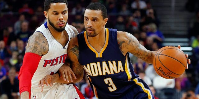 Indiana Pacers guard George Hill (3) drives against Detroit Pistons guard D.J. Augustin (14) in the first half of an NBA basketball game in Auburn Hills, Mich., Friday, Dec. 26, 2014. (AP Photo/Paul Sancya)