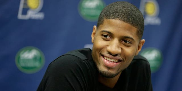 Paul George responds to a doubt during a news conference, Aug. 15, 2014, in Indianapolis. (Associated Press)