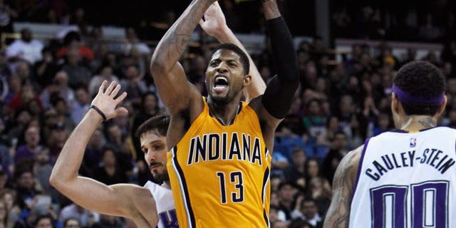 Indiana Pacers forward Paul George (13) is fouled by Sacramento Kings defender Omri Casspi, rear, during the second half of an NBA basketball game in Sacramento, Calif., on Saturday, Jan. 23, 2016. The Kings won 108-97. (AP Photo/Steve Yeater)